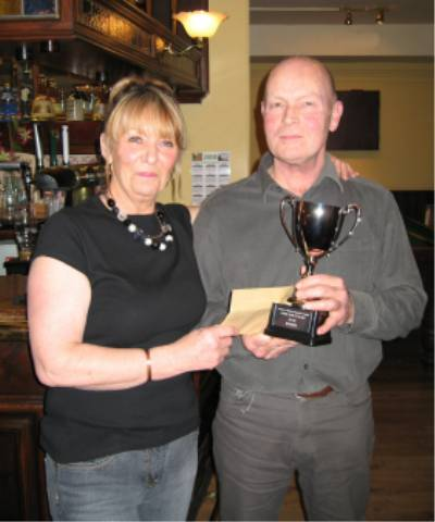 Judy presents Dave with the Winners Trophy